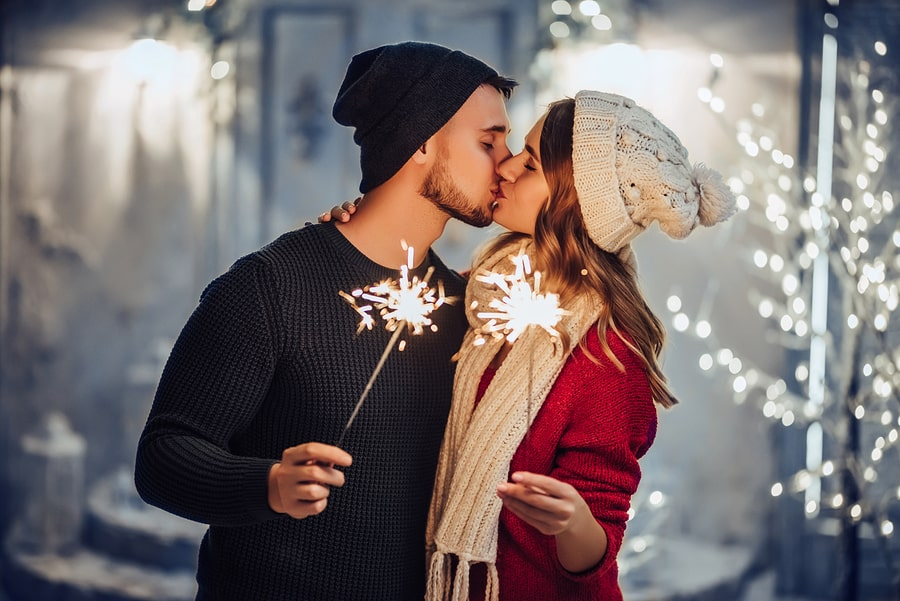 Young romantic couple is having fun outdoors in winter