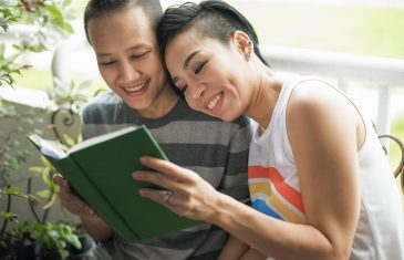 LGBT couple on Valentine's Day reading