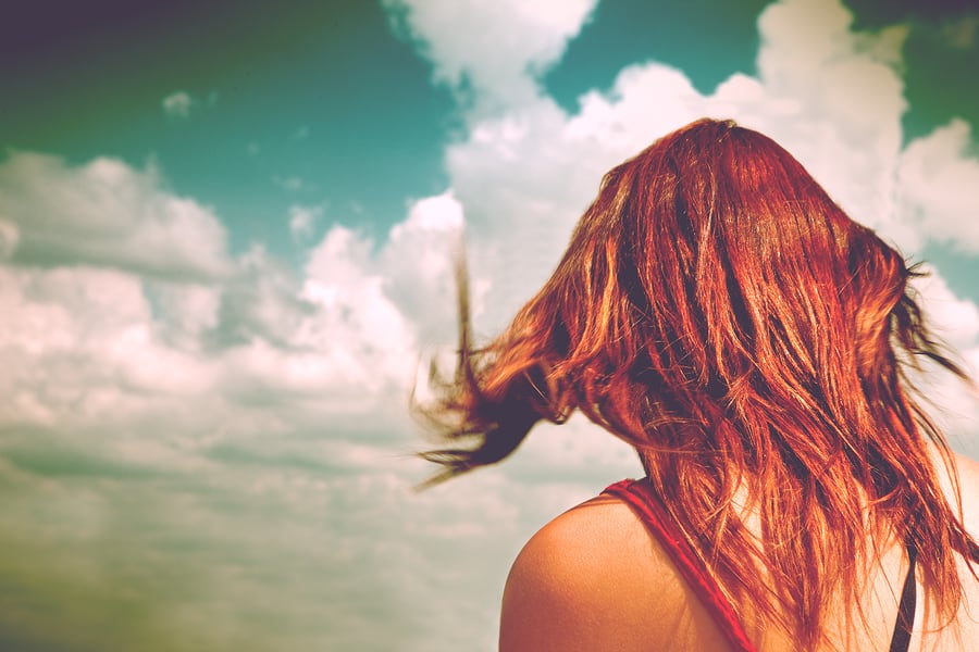 Anonymous Woman With Red Hair And Blue Sky.woman On Her Back Wit