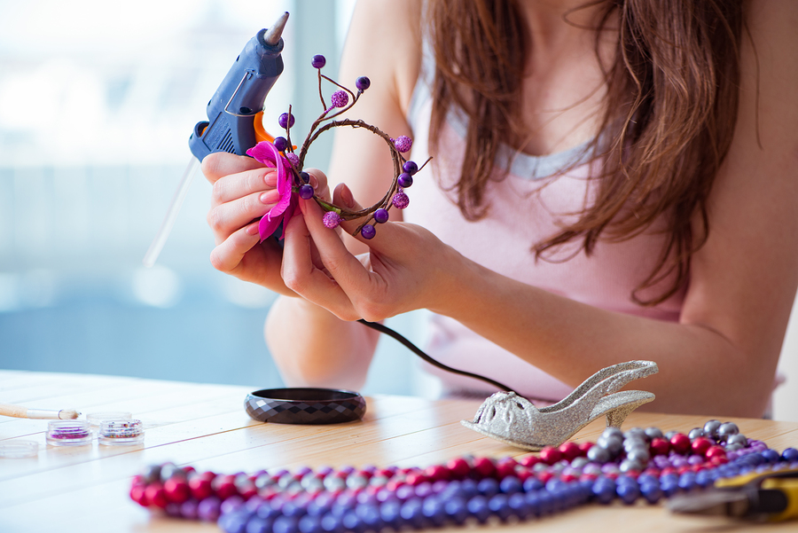 Woman making jewelry at home